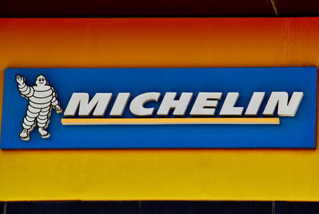 Michelin logo on a facade. Michelin is a tire manufacturer based in Clermont-Ferrand in France and it is one of the three largest tire manufacturers in the world.