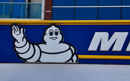 Michelin logo on a facade. Michelin is a tire manufacturer based in Clermont-Ferrand in France and it is one of the three largest tire manufacturers in the world. Redactioneel