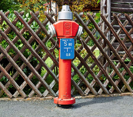 Red fire hydrant available of firefighters to tame the fires