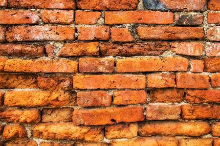 textured wall: Brick wall brown orange textured Stock Photo