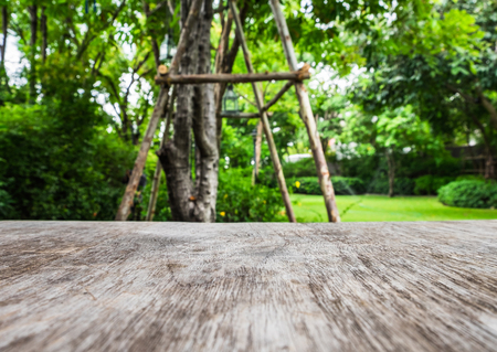 breezy: Wood table foreground on garden breezy environment scene