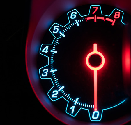 miles: Mile car speedometer with needle number glowing Stock Photo