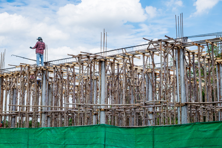 roof framework: Construction work with wood steel mortar and people Stock Photo