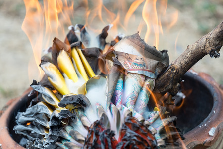 burning money: Burning paper silver and gold in chinese festivals