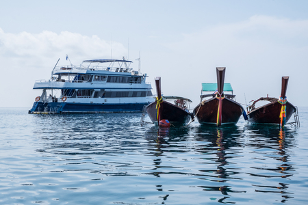 transportaion: Longtail boat and ferry ship anchor on lipe sea