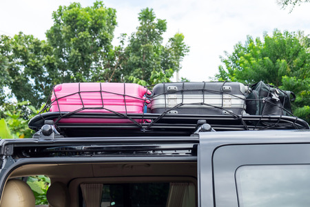 duffel: Rack on the roof van color luggage stack Stock Photo