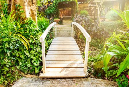 sylvan: White bridge across walkway sylvan in garden