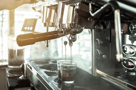 green tone: Large coffee maker two head elegant in coffee shop, green tone