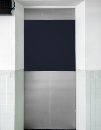 lift gate: Stainless elevator gate with blank banner Stock Photo