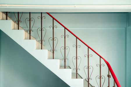 banister: Railing banister stairs down  curved steel vintage style Stock Photo