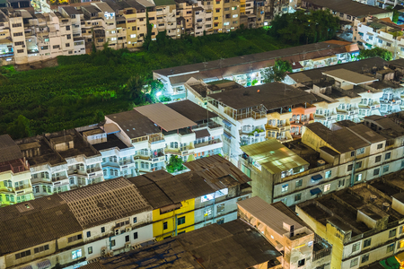 House village crowded light neon in capital at night