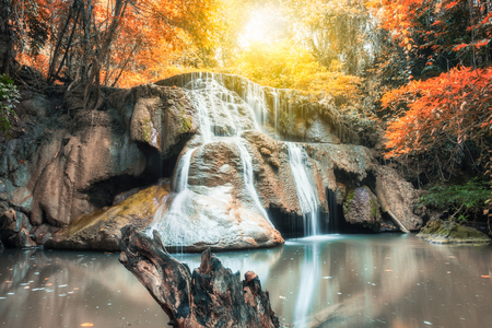 Cliff rock in waterfall gold rainforest at huai mae khamin national park,kanchanaburi,thailand