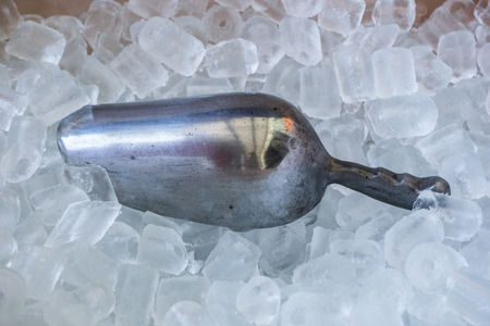 Metal spoon with ice cube