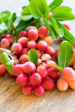 Carunda,Karonda,Carissa carandas,Apocynaceae,fruit red seed nutritious on wooden table Stock Photo