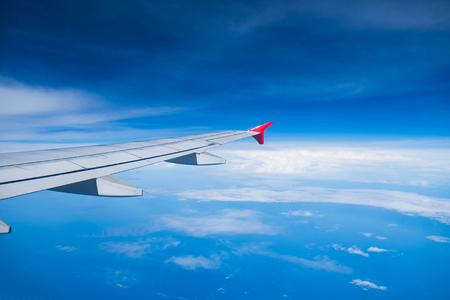 View airplane cloudy in blue sky Stock Photo