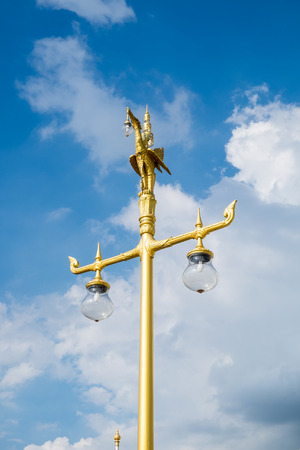 Swan statue on top pole gold and blue sky