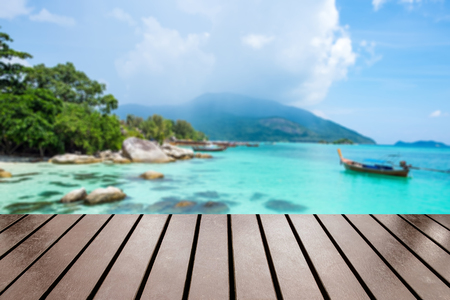 Wood table top on blurred ko lipe tourist attraction wonderful of south