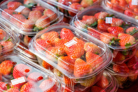 Strawberry ripe packed in plastic boxes Stock Photo
