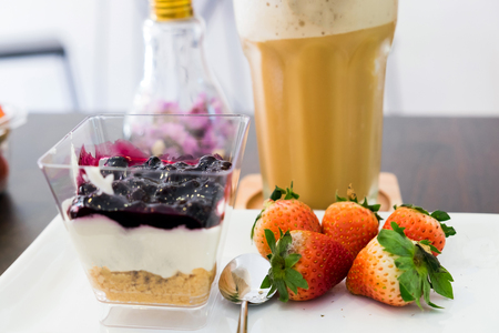 Cappuccino coffee blueberry dessert and fruit strawberry Stock Photo