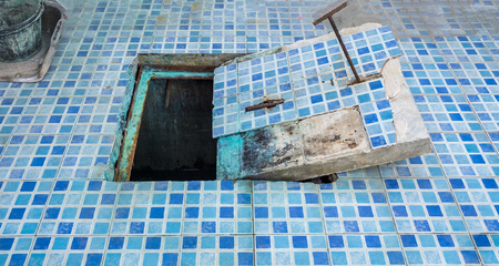 Cap drain decay industry in pool area Stock Photo