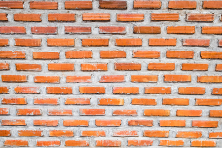 Brick orange on mortar wall background