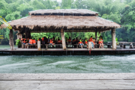 Wood plank gray on blurred scene tourist floating raft green jungle in sai yok river kwai Stock Photo