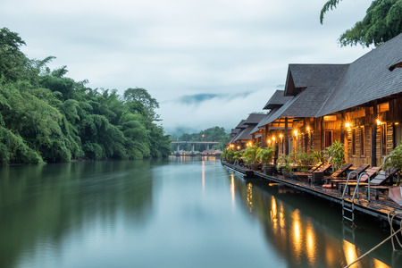 Resort wooden house floating and mountain fog on river kwai at sai yok,kanchanaburi,thailand Stock Photo