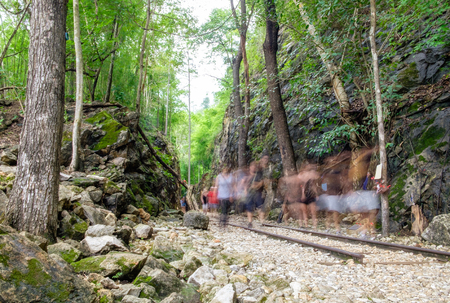 Valley strait history of world war II,blur tourists walking in hellfire pass,kanchanaburi