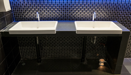 Washstand,sink two white ceramic on counter decorate mosaic luxury wall