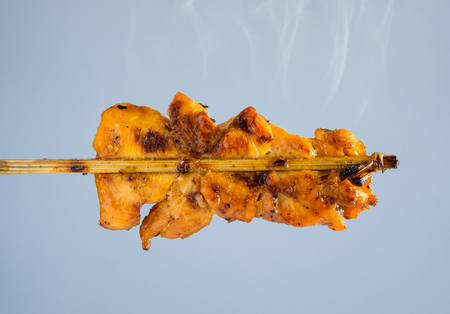 Grilled chicken skewers with smoke,isolated on background