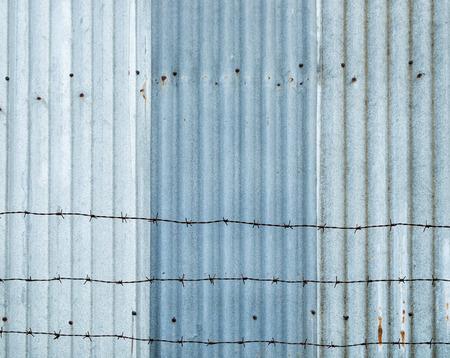 Corrugated blue zinc iron and spire background Stockfoto