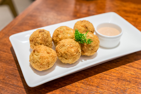 Clams cheese ball bake cooked on white plate