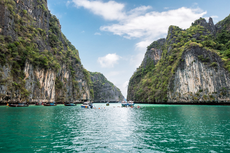 Pileh lagoon limestone mountain surrounded and emerald sea with tourists traveling at Krabi, Phi Phi island, Thailand