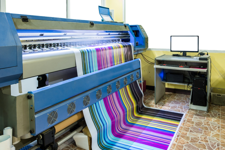Large inkjet printer working multicolor cmyk on vinyl banner with computer control in printing plant