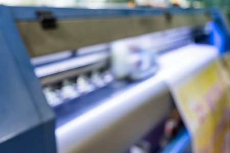 Blurred scene inkjet print head color working on yellow vinyl banner