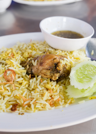 Rice with curried chicken biryani with sauce sweet and sour