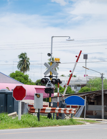 Electric poles with label sign crossing on railway Imagens