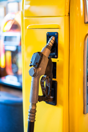 Fuel nozzle lock on yellow petrol pump Stock Photo