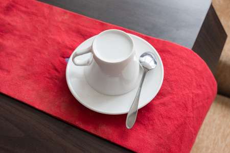 White ceramic cup set prepare on red cloth and wood table Reklamní fotografie