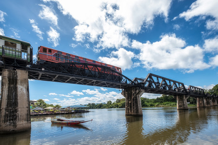 Low angle train running on histotic railway of River Kwai bridge at Kanchanaburi 스톡 콘텐츠