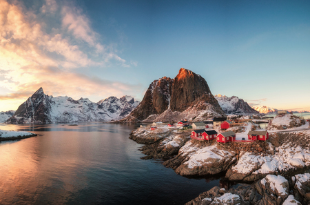 Red house fishing village with snow mountain at sunset, Hamnoy, Lofoten, Norway