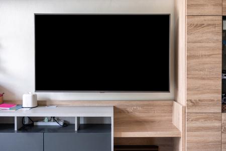 LED Flat Screen TV hanging on wooden closet Stock Photo