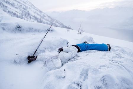 Man mountaineer sleeping death on snow ridge
