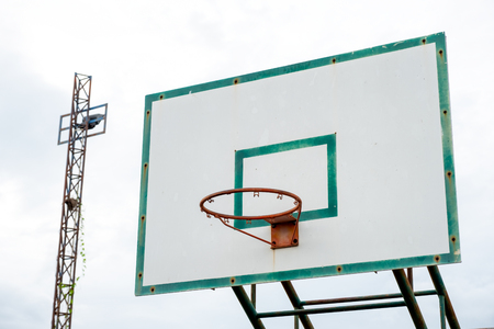Wood basketball backboard with hoop green frame and aged weathered 写真素材