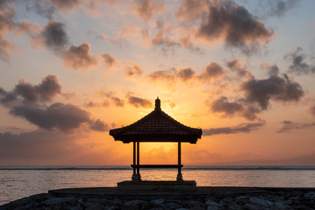 Sunshine in pavilion on jetty at coastline in morning. Sanur beach, Bali