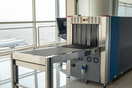X-ray scanner baggage and metal detectors with conveyor belt in the airport Reklamní fotografie