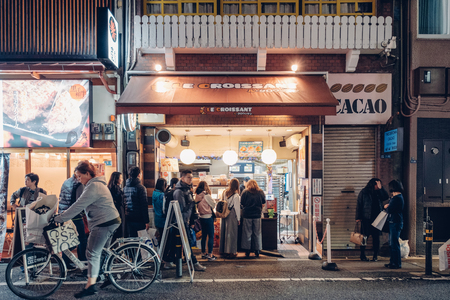 Osaka, Japan - Nov 11 2017 : Tourists stand queue to wait to buy bread on Le croissant shop