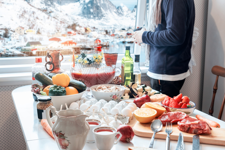 Man holding cup with sightseeing view in winter and preparing foods in Christmas festive