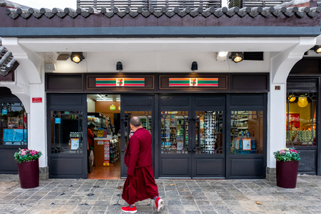 Hong Kong, China - May 04 2018 : Monk walking to convenience store in temple, located in the high mountain at Polin monastery