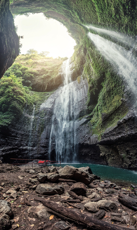 Majestic Madakaripura waterfall flowing in rocky valley at East Java, Indonesia Imagens